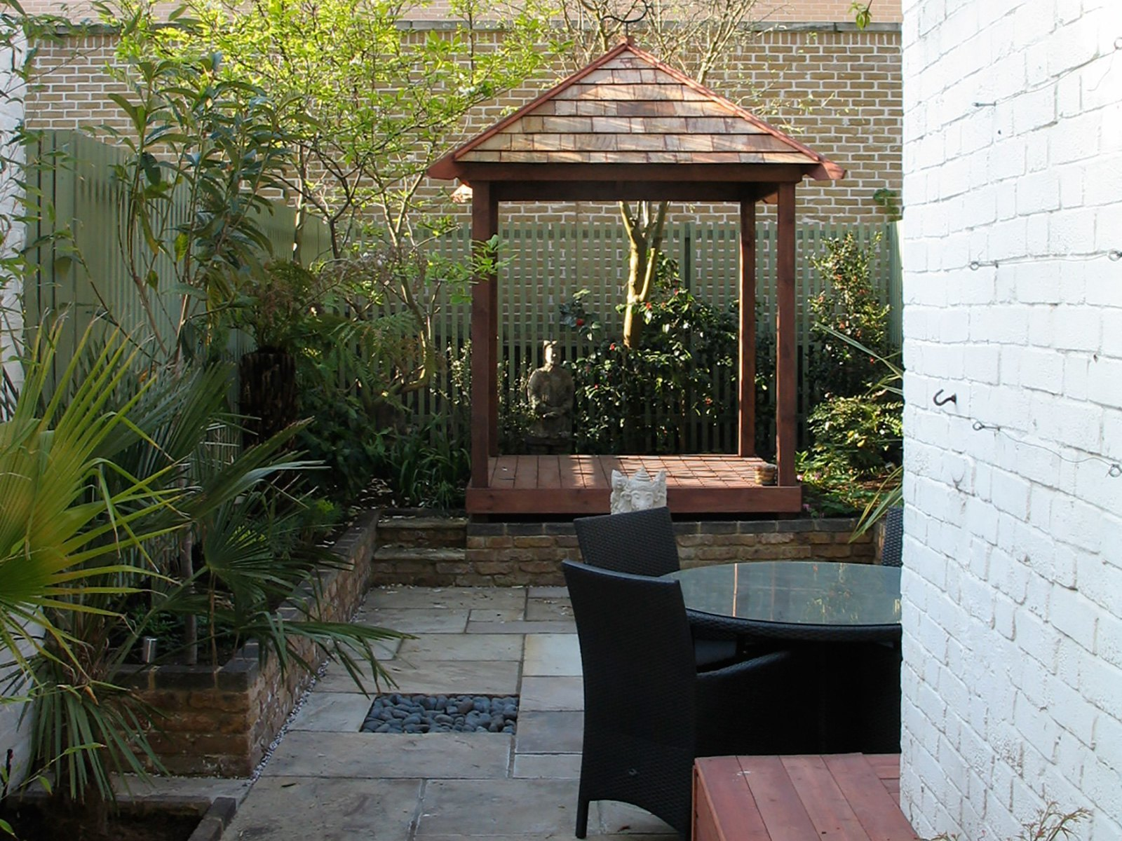 An outdoor room for daily use with a pavilion designed especially for yoga and meditation.