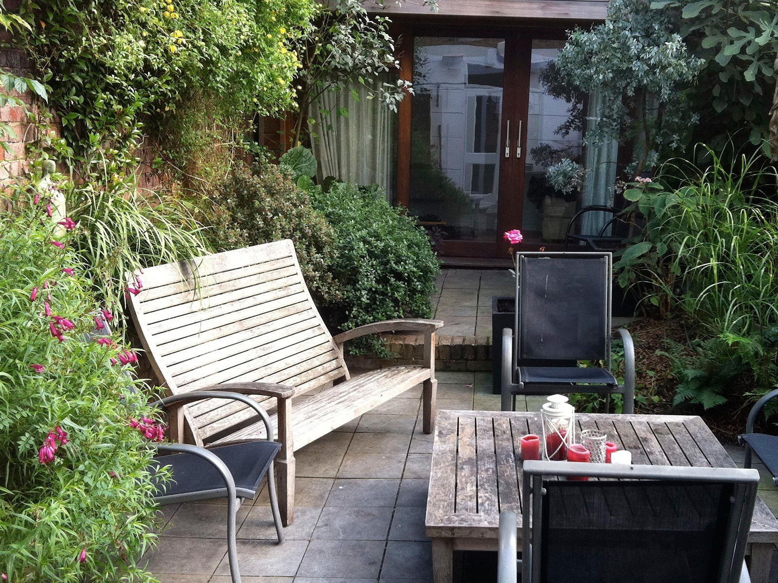 This well-established garden is surrounded by high walls and buildings but is the perfect place to unwind in the evening sun.