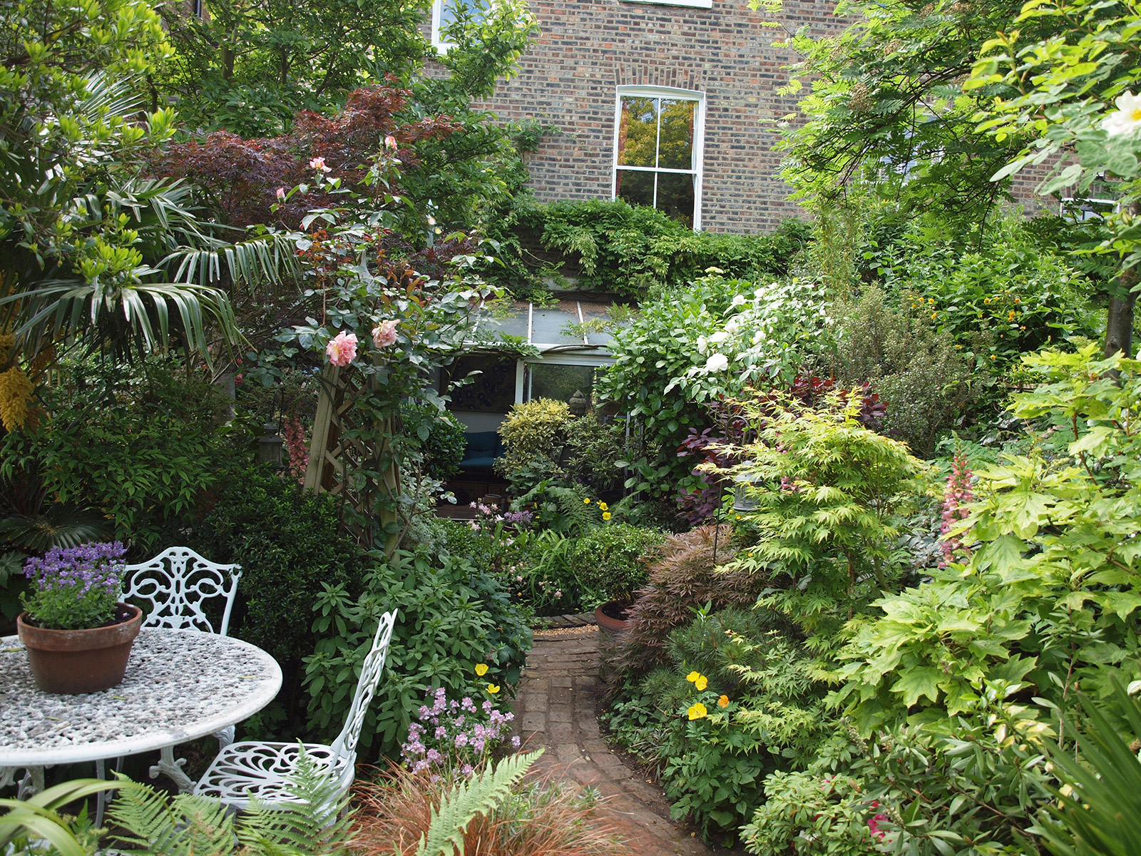 This garden provides several different sitting areas and views and offers a high level of privacy.