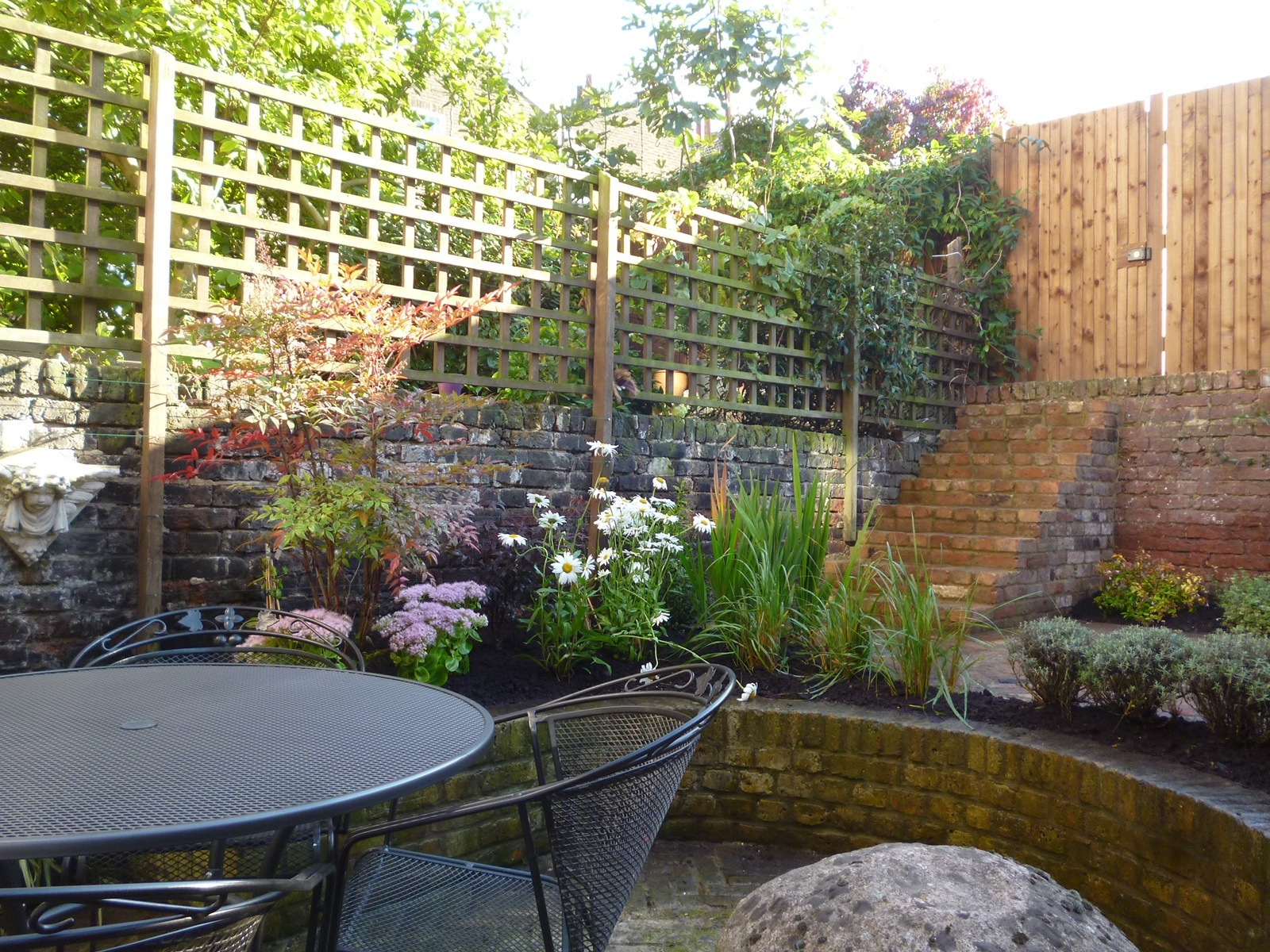 Another newly-finished small garden that will quickly turn into a have for humans and wildlife.