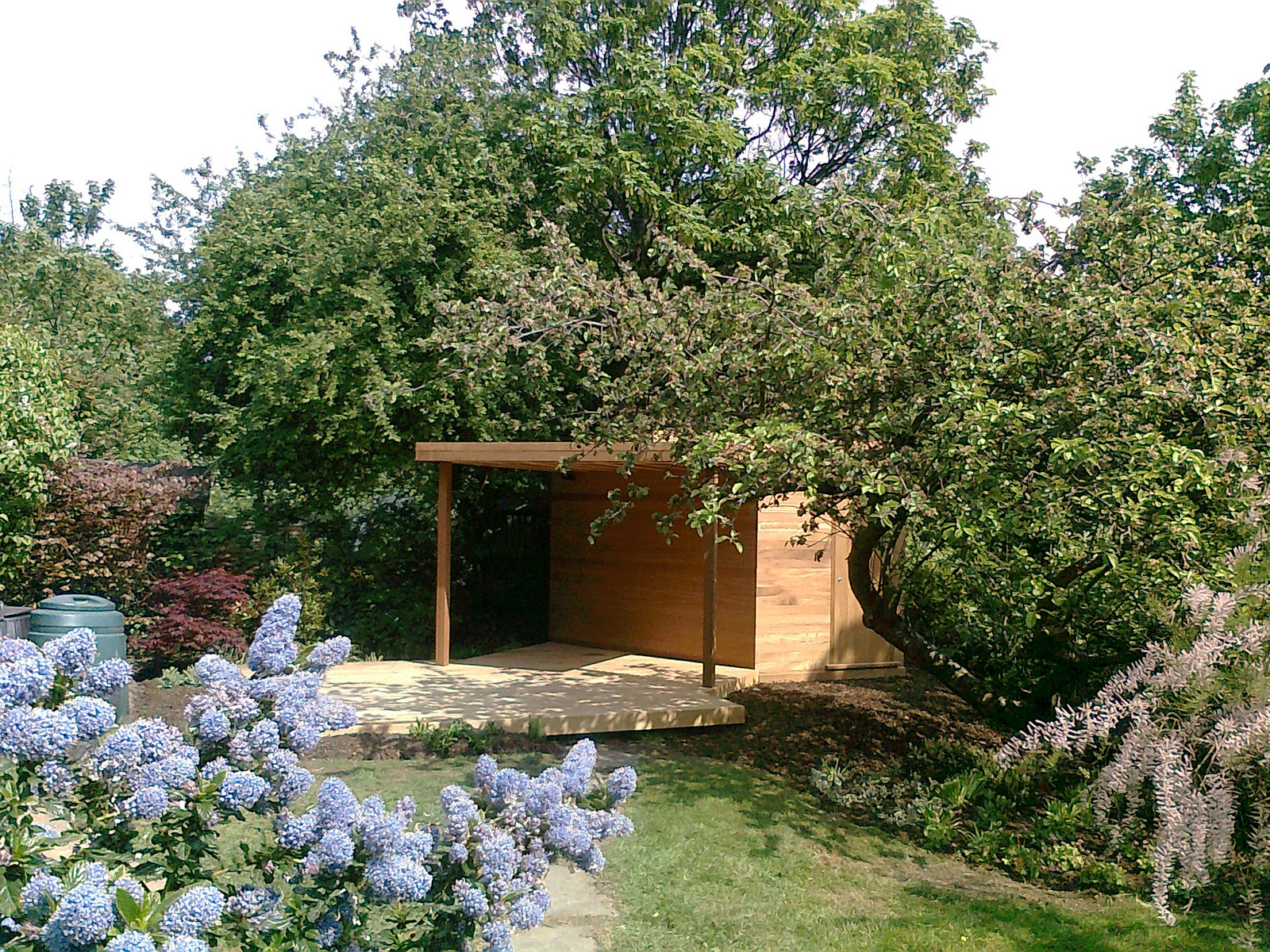 These clients wanted a sitting area, an awning and a good sized shed at the sunny end of their garden. This bespoke