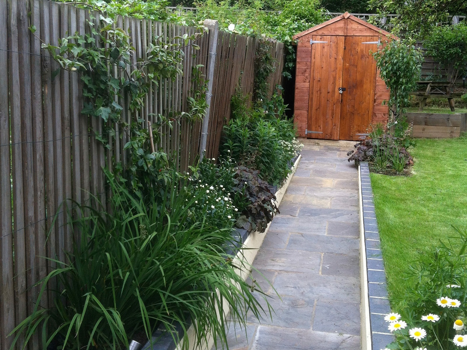 Easy access to the garden shed: vital in a family garden to store toys and garden equipment.